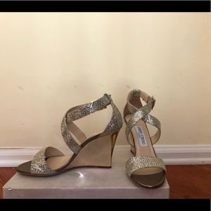 Jimmy Choo shoes with a gold wedge